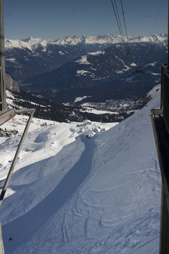 View down the valley from the cable car going up to Grauberg lift station with stunning views across to the mountains of the Laax, Flims, Falera Winter snow and ski resort ©Gregory Goldston