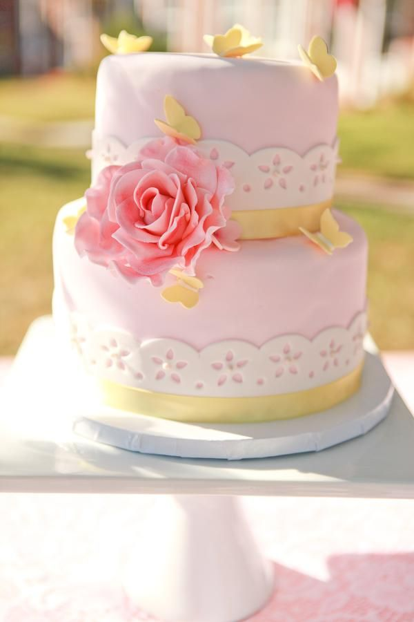 Yellowe and pink butterfly cake. Love the simplicity and elegance of this cake.