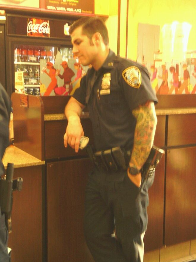 #tattoo sleeve on a cop ....yeah, who doesn't like a man in uniform? It proves he's got a job.