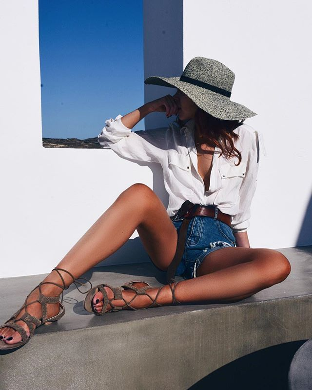 white button down blouse | high waisted denim shorts | strappy sandals | grey sunhat
