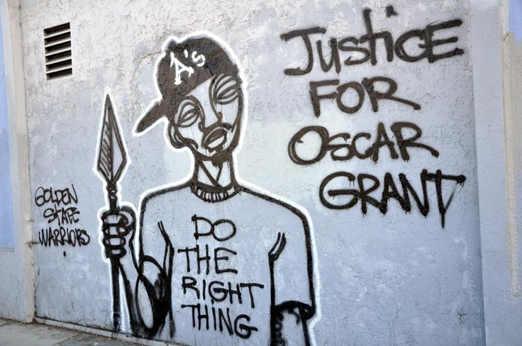 Oscar Grant mural at 75th and MacArthur Blvd. in East Oakland. (Jennifer Courtney/ CALIFORNIA BEAT PHOTO)