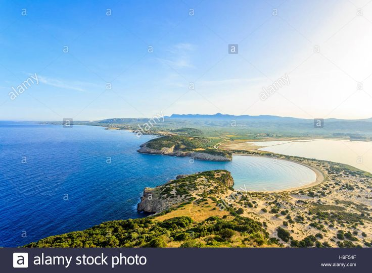 Download this stock image: distant aerial view on Voidikilia beach from Paleokastro fortress, early morning - H9F54F from Alamy's library of millions of high resolution stock photos, illustrations and vectors.