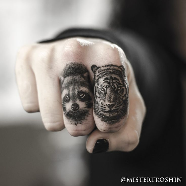 Tiger and raccoon finger tattoos