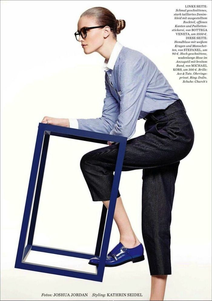 Collared button-up shirt tucked into high-waisted denim trouser pants worn with blue monk-strap oxfords for ELLE Germany. Photo: Joshua Jordan