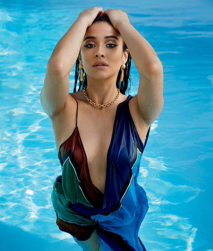 Shay Mitchell takes a dip in the pool wearing Diane von Furstenberg dress