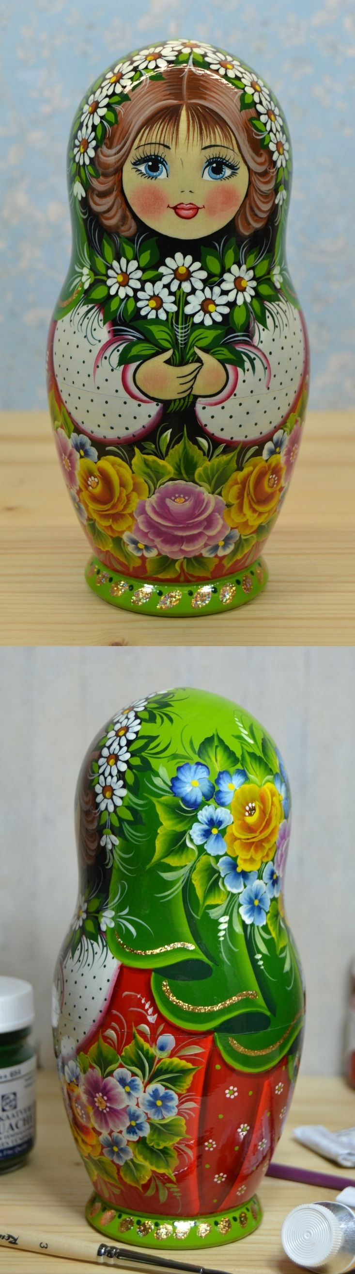 Wooden babushka doll in green decor with bunch of daisy flowers, hand painted by artist Valentina Partanen. Find more gorgeous nesting dolls at: www.bestrussiandolls.etsy.com