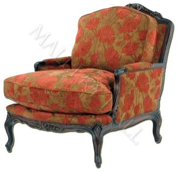 custom made club chair outfitted in designer upholstery trimmed by