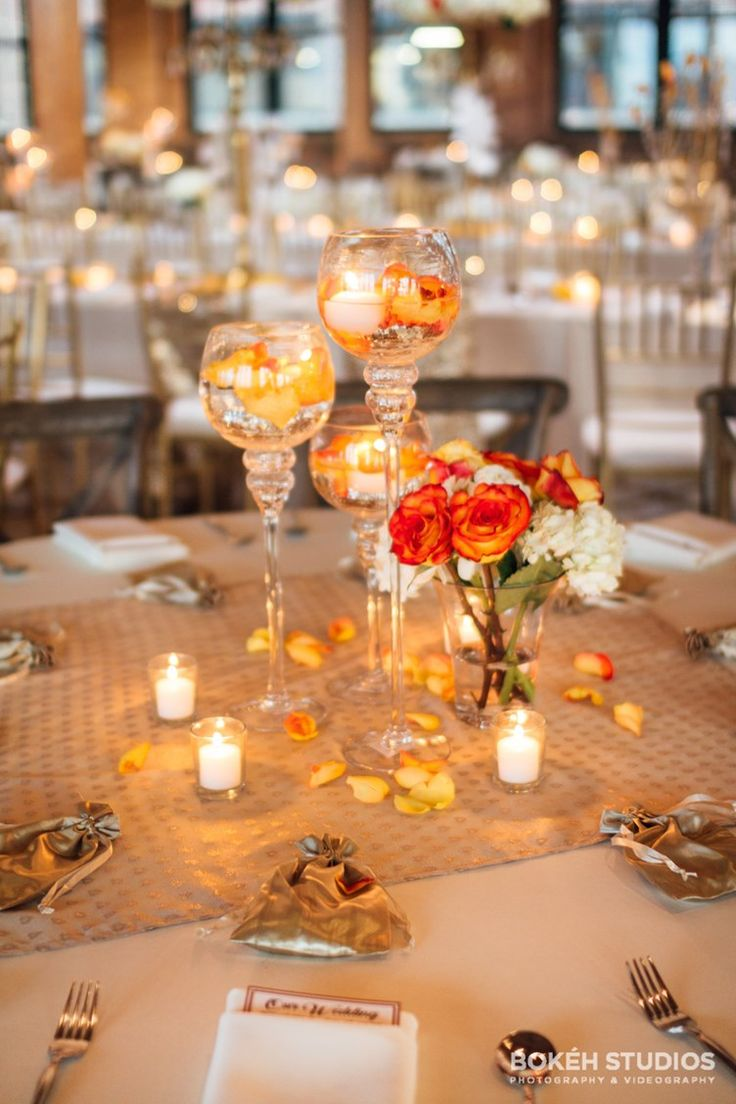 peach and gold centerpiece decoration with candles and dark orange roses | wedding table decor ideas