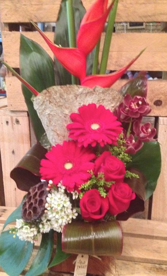 This weeks bold red corporate arrangement with tropicals, gerberas and roses for the Lake Cafe at Varsity Lakes, made by Twigs Florist