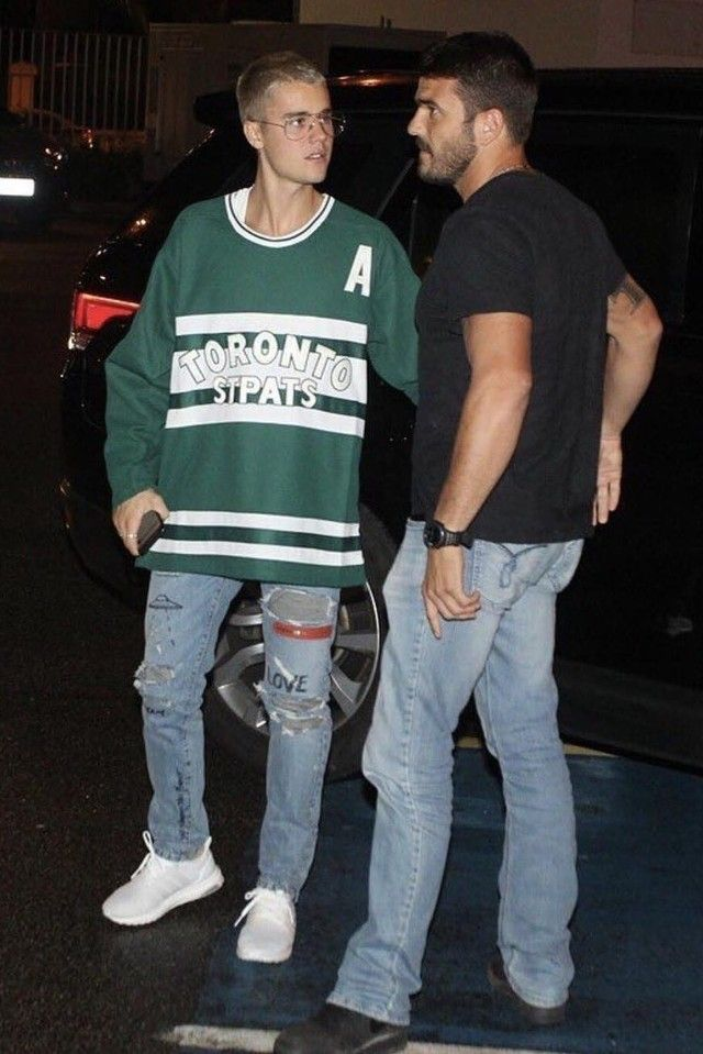 Justin Bieber wearing  Vintage Toronto St Pats Jersey, Visitor on Earth Distressed Skinny Jeans, Adidas UltraBOOST 3.0 Running Shoes