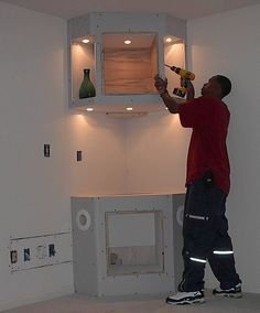 built in corner cabinet IDEA for second tower to hide the slanted wall? and then continue tv area w/...something like this? http://www.pinterest.com/pin/16255248630071071/