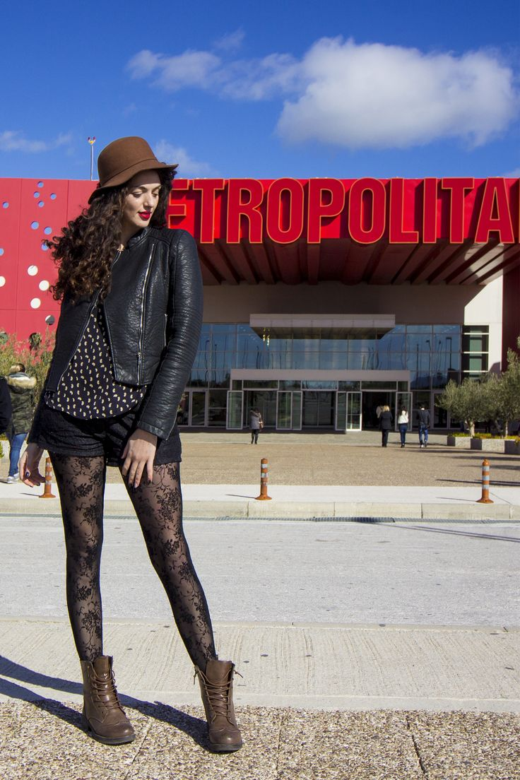 Hat obsession in a rocky chic style. Brown hat, flower fashion tights, leather jacket and boots