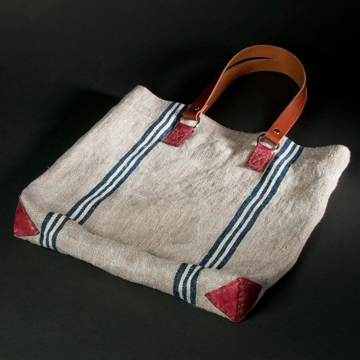 Handmade from vintage farmers linen (approx. 100 years old) with dark blue stripes, in  trendy Mediterranean look with brown genuine leather handles and other burgundy-colored leather applications .  Inside lining of dark blue cotton fabric, and extra cell phone pocket,  Inside closing with 2 leather straps.    Each bag is completely handmade and unique with its timeless design. It's a Must Have!    Size: 45cm x 40cm x 8cm  Handle length: 54cm