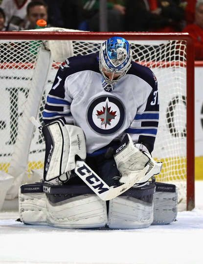 CHICAGO, IL - DECEMBER 27: Connor Hellebuyck #37 of the Winnipeg Jets makes a save against the Chicago Blackhawks at the United Center on December 27, 2016 in Chicago, Illinois. The Jets defeated the Blackhawks 3-1. (Photo by Jonathan Daniel/Getty Images)
