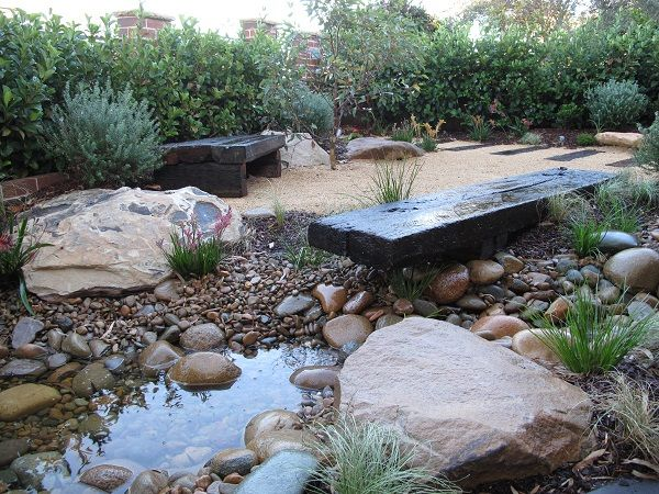 Modern Australia Native Garden Design Recycled Sleeper Pathway leading to front doorway.