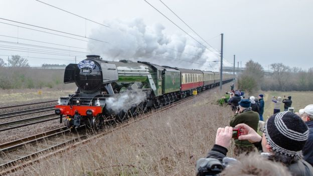 One of the world's most famous locomotives has completed its inaugural run after a decade-long, £4.2m refit. The Flying Scotsman made the journey from London King's Cross to York, where it will go on display at the National Railway Museum (NRM).