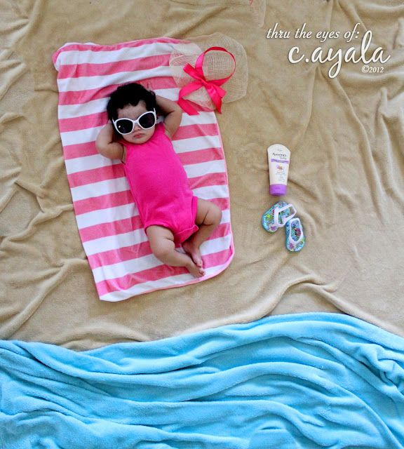 Staged baby beach Photo Photo Props: *Brown & Blue Blanket * Pink Baby Bath Towel  *Sunglasses from Carters *Aveeno Baby Sunblock *Baby's Sandals *Doll Hat (ribbon to match the outfit!) Location: Living Room Floor