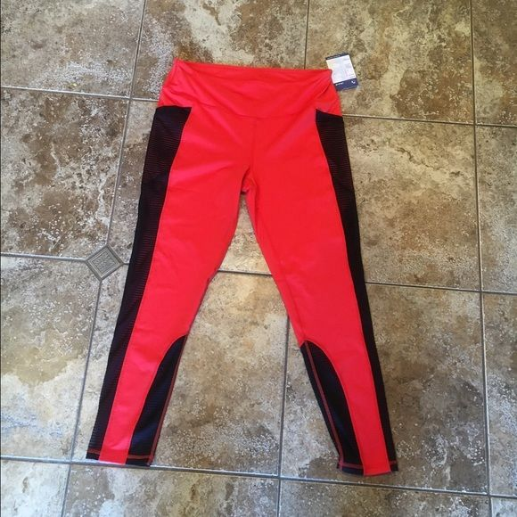 NWT Without Walls athletic leggings BRAND NEW with tags. Bright red with black mesh paneling. Very cool details, in style! These leggings are full length, no see through. Size Large. Without Walls brand is part of Urban Outfitters company. These are sold out online. Retail $68. Bought them online but are a smidge too big for me. Without Walls Pants Leggings
