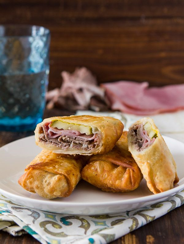 crispy cuban egg rolls with thinly sliced roast beef, thinly sliced smoked ham, swiss cheese & claussen sandwich pickles.