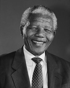 Nelson Mandela newspaper - Newspaper style handout with questions about Nelson Mandela.