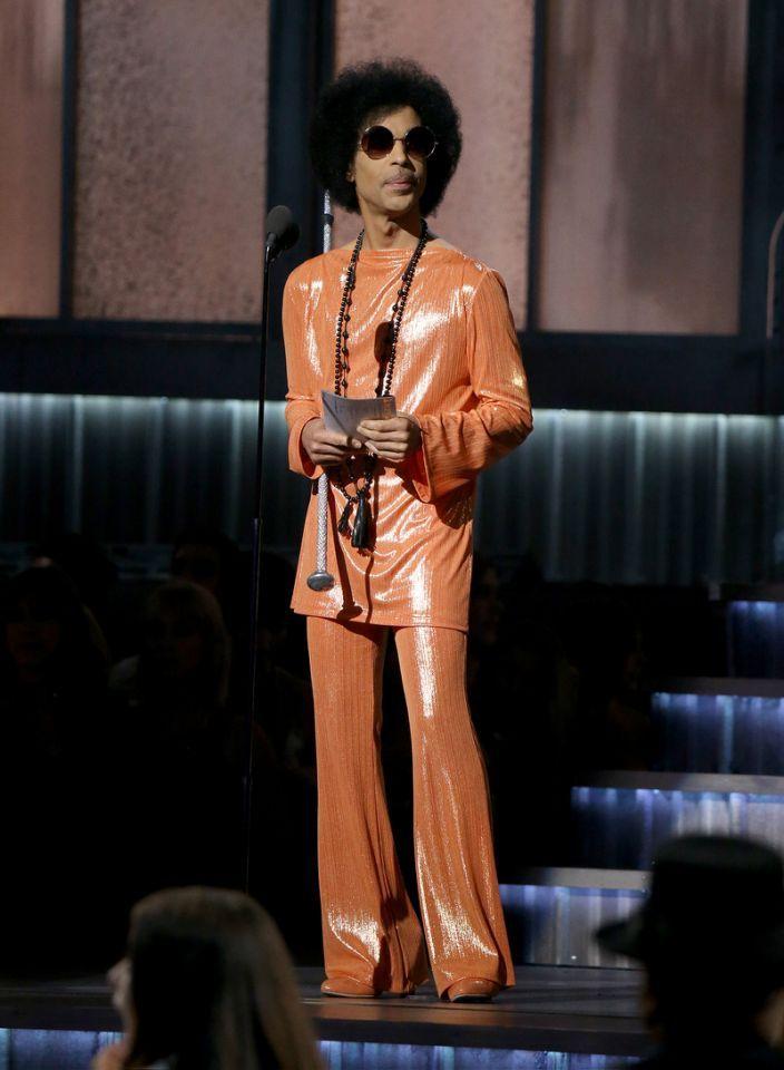 Image result for Prince in orange jumpsuit