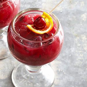 Cherry Sangria - Stir together a chilled bottle of Zinfandel, cherry syrup, and freshly squeezed orange juice to make a refreshing red sangria. Cherry-orange skewers make gorgeous garnishes.
