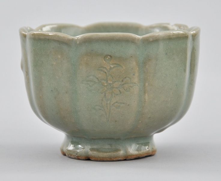 "A Korean Celadon Cup, ca. Koryo Dynasty, ca. 13th-14th century. Earthenware with green celadon glaze in high gloss finish. Cup has segmented round form with scalloped rim and similar foot, . 2-1/4""T x 3-1/4""D."