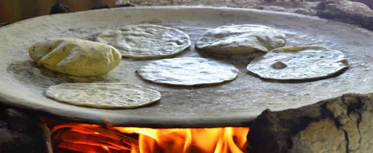 A Mexican Clay Comal, locally known as a comal de barro, is coveted by cooks for their slow heat distribution and retention. As its Aztec name (comalli) suggest