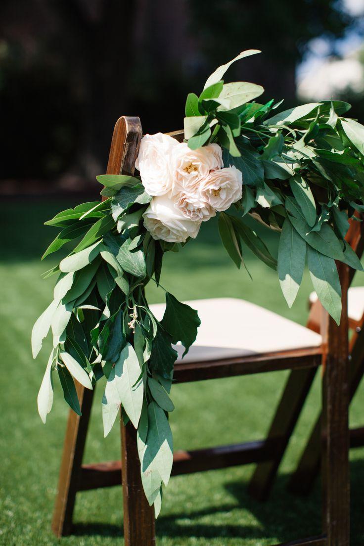 Leafy chair decor, blush florals, romantic outdoor wedding ceremony decor // Melissa Maureen Photography