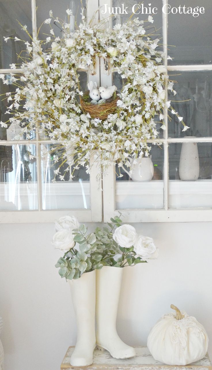 neutral fall decor white rainboots  filled with faded greenery and flowers. Completely romantic fall decor ideas