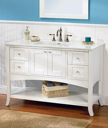 "Fairmont shaker 48"" vanity in polar white.  Lovely curve above the open shelf."