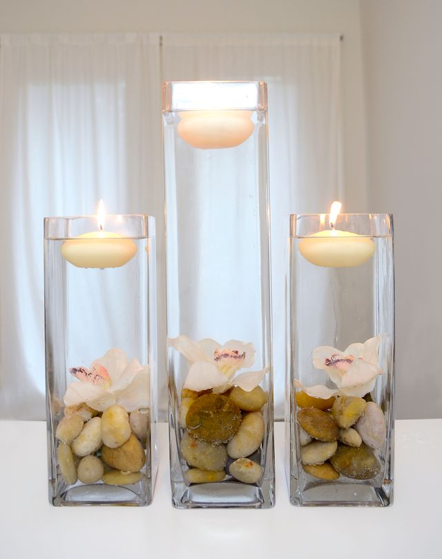 DIY Home Decor Vases with Floating Candles and Flowers--center piece--if the flowers were longer, it'd be prettier, Dollar store candles, vases, and fake flowers. Hot glue the flowers to the bottom of the vase, add stones, fill with water, and add the candle! Easy, cheap and pretty