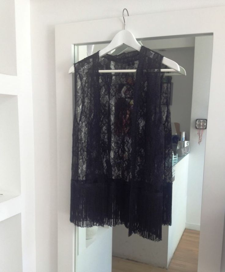 "Black lace vest with ""oh so hot right now"" black fringes!"