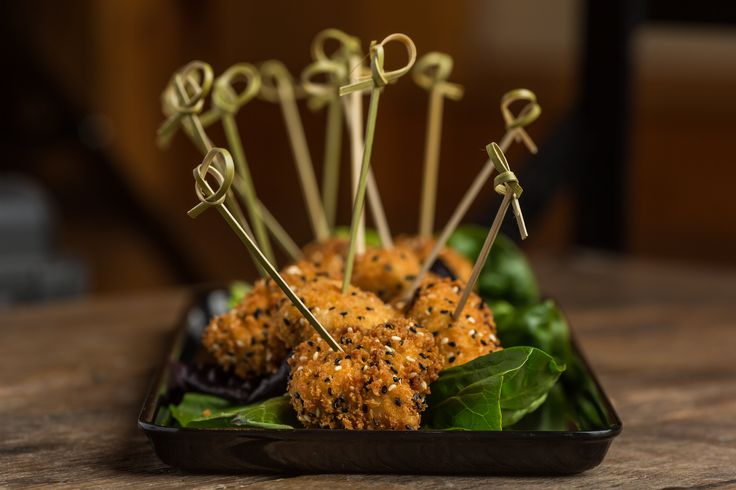 Sesame crusted chicken sate, served with a Thai peanut sauce. This appetizer is made in-house and from scratch at Temple's Sugar Bush.  Venue: www.templessugarbush.ca Photo Credit: www.unioneleven.com