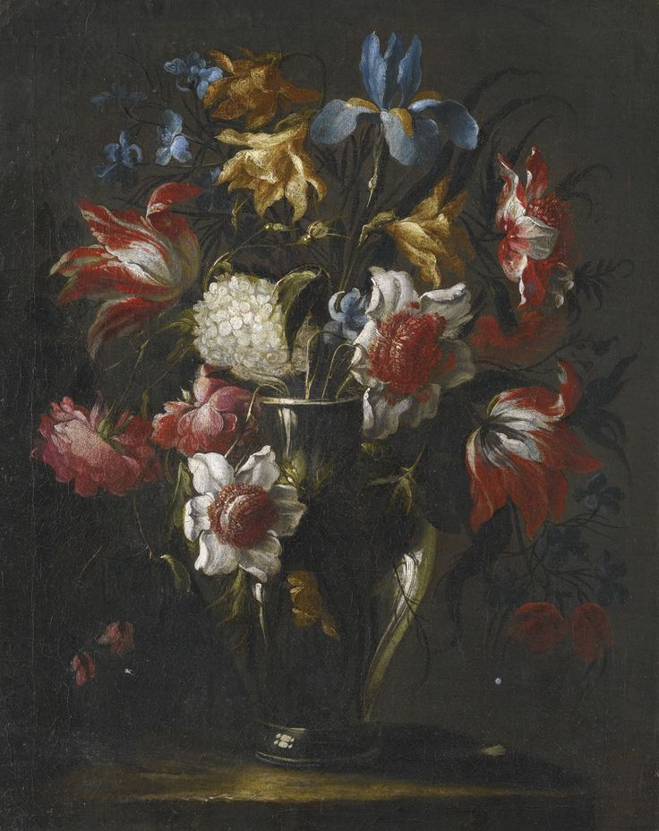 Juan de Arellano SANTORCAZ 1614 - 1676 MADRID BLUE IRISES, PARROT TULIPS, ANEMONES, PEONIES AND OTHER FLOWERS IN A GLASS VASE, ON A STONE LEDGE