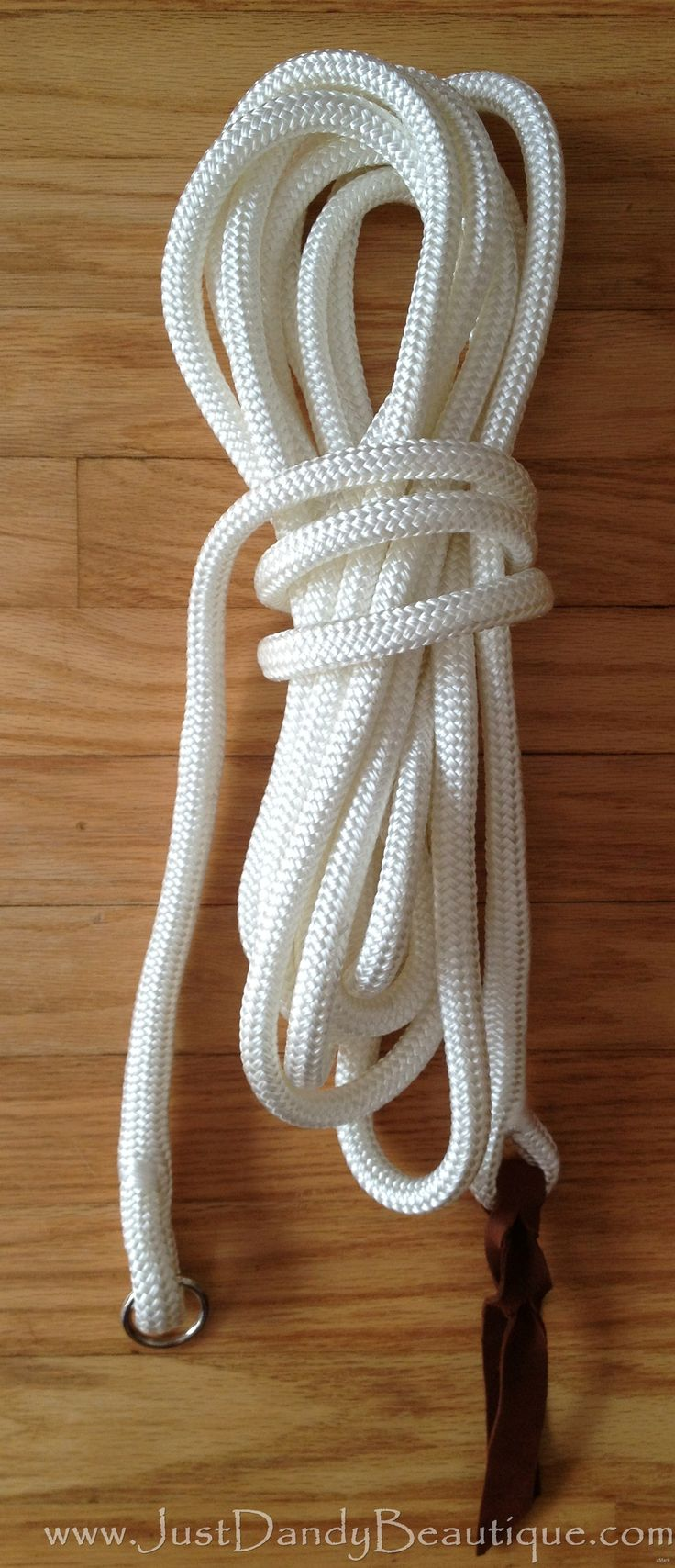 Hand spliced, Polyester Horse Longe Line.  Hardware Optional.  We hand splice our own longe lines. Our longe lines are 22′ long and can be used with any of the clinician training programs.      Made from 1/2″ polyester marine grade yacht line. This rope is soft enough on the hands, yet UV resistant and will take years of abuse.      Includes our hand cut leather bleeding heart knot popper.  (Need a replacement popper? We sell those too!)    Buy online at www.justdandybeautique.com! #horse…