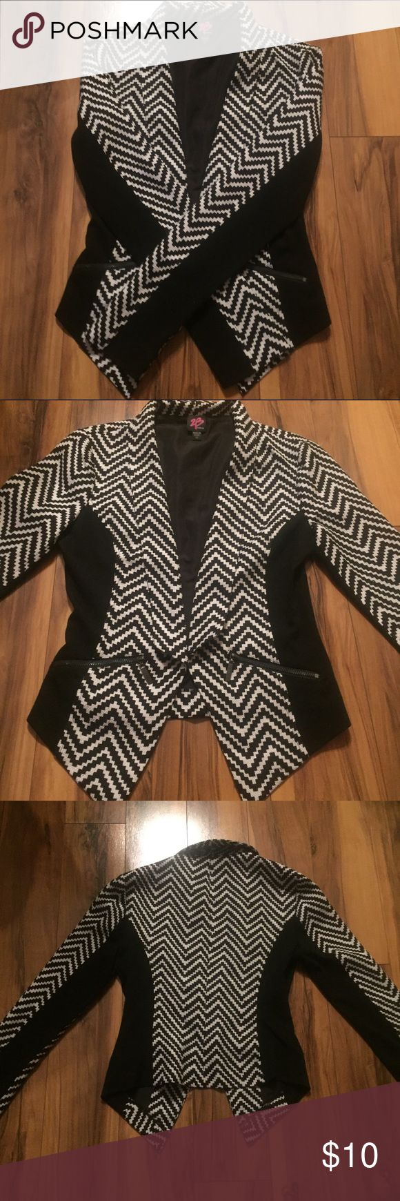Bebe Blazer I love this chevron black and white blazer! Its from Bebe size xs. The design is sexy and slimming. There are 2 zippers on front, not real pockets. Wear with skinny black ankle pants and strappy heels. There is a small defect in the back upper arm, shown in pictures above. bebe Jackets & Coats Blazers