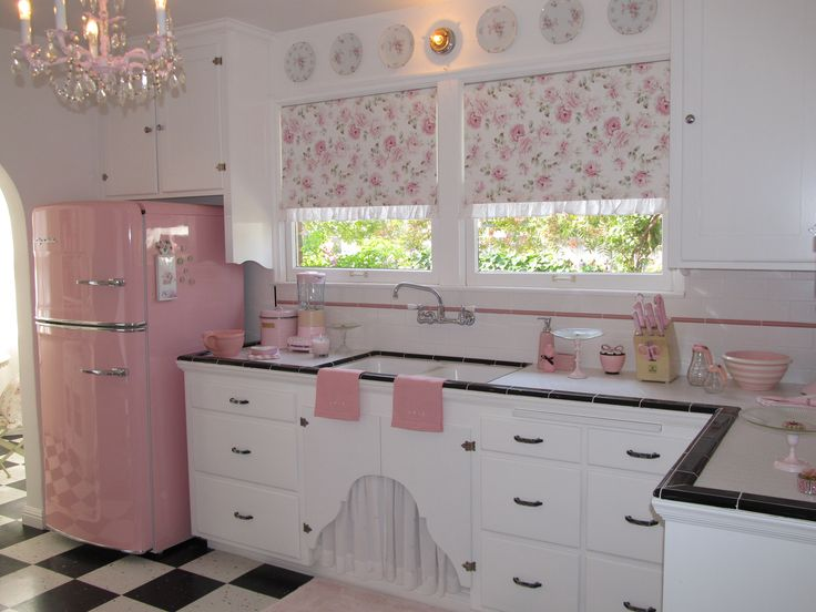 A retro pink kitchen-love the fridge,chandelier,sink and blinds so perfectly pretty. Love the floor too, and the black trim on counter tops.