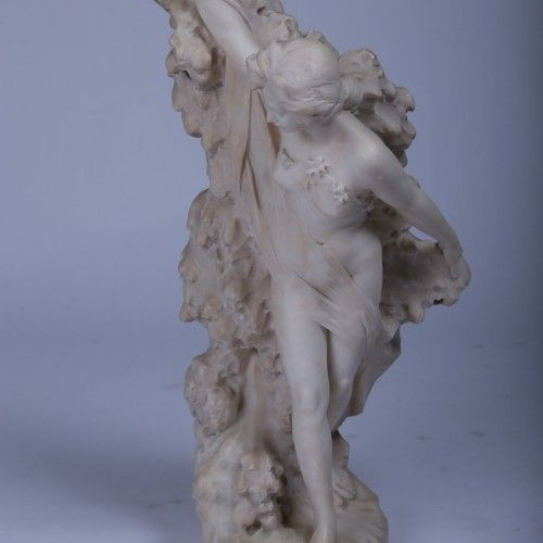"G. GAMBOGI (SCULPTOR)  Epoque : 1900 Dimensions : H. 66cm. L. 33cm. P. 24cm.   ""Nude Woman"" Carrara marble sculpture of a semi-nude woman covered with a sheet. Signed by G. Gambogi. Circa 1900."