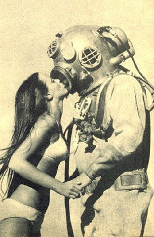 Who doesn't love an explorer? If your suit is this old, might be time to visit our store! Vintage style photo - scuba diver kissing girl in bikini