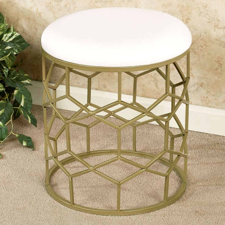 Monarch Round Vanity Stool Gold $95. Available in gold or bronze. Buy 2, take off seats, and use as bases for glass tops to make 2 cocktail tables.