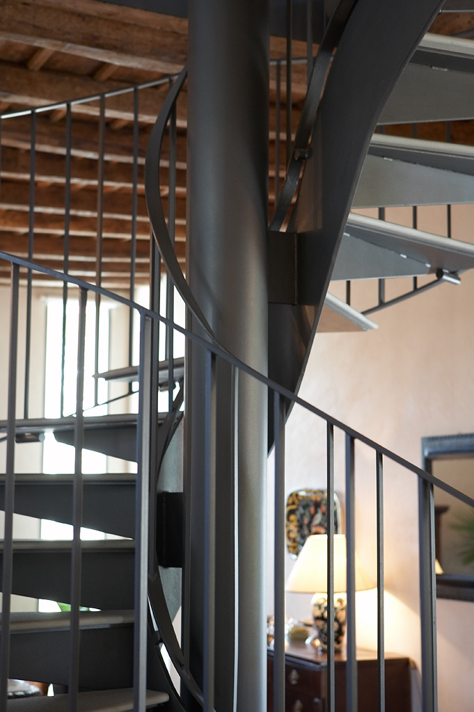 iron and stone staircase for the renovation of a farhouse