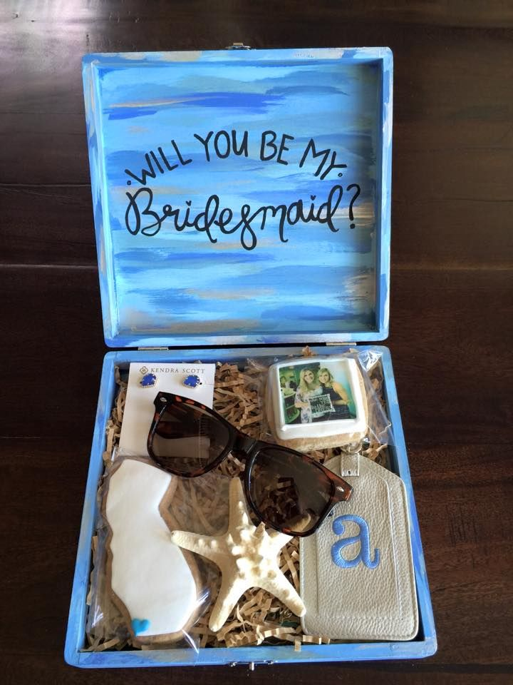 "Hand-painted ""Will you be my Bridesmaid?"" cigar boxes! Filled for a destination wedding to California with monogrammed sunglasses, luggage tag, earrings, California cookie, and instagram cookie with each bridesmaid!"