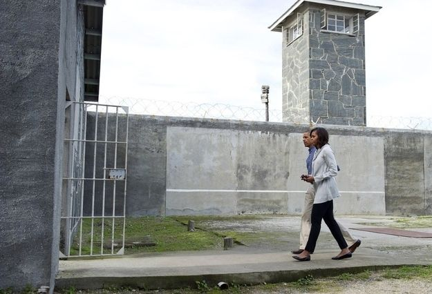 President Obama and the first family visited the apartheid-era prison on Robben Island, South Africa, Sunday where Nelson Mandela and other anti-apartheid leaders were jailed as political prisoners. | 16 Moving Images From President Obama's Visit To Nelson Mandela's Jail Cell