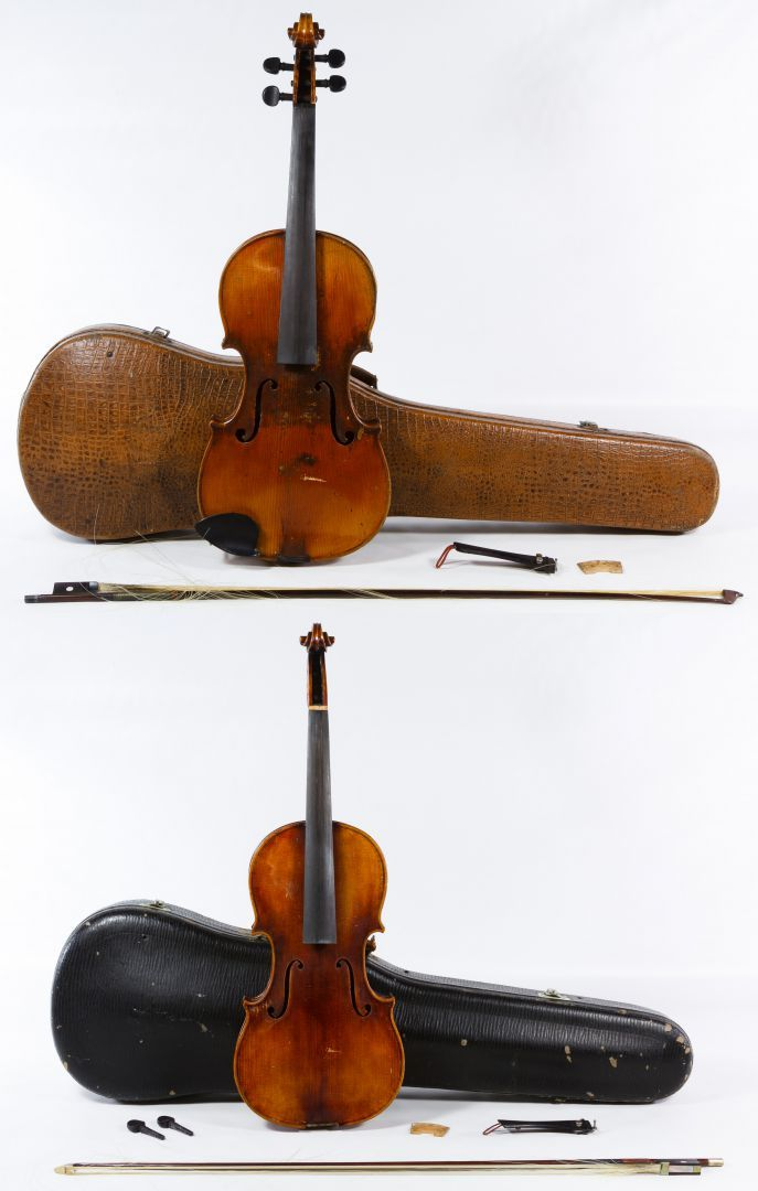 "Lot 389: Violins in Cases; Two items including an Antonio Stradivarius Cremonensis"" labeled violin made in Czechoslovakia and a violin with a ""Nicolaus Cremoneria Hieroni"" marked label inside"
