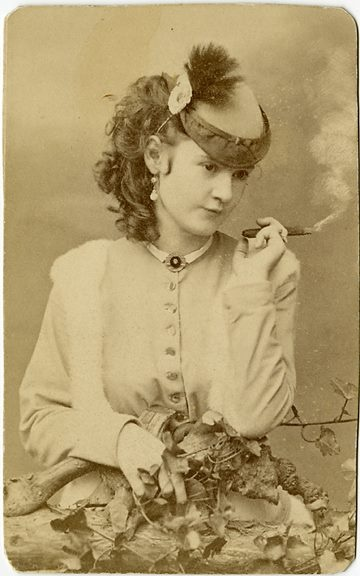 Lotta Crabtree smoking a cigar. She was a major singer-actress in the 1880s earning up to 5K a week and when she died in 1924 she left an estate worth 4 million.