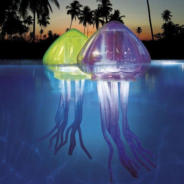TheOcean Art Light-up JelliesfromSwim Waysare eerily life-sized jellyfish decorations for swimming pools.  Eachlight-up jellyfish has LEDs inside and glow as they float ac: Pool Toy, Pool Ideas, Outdoor, Jellyfish Pool, Pools, Jelly Fish, Jellyfish Light