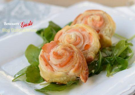 Rotolini di salmone in pasta sfoglia, ricetta per gustosi antipasti e stuzzichini perfetti anche per l'ora dell'aperitivo, ricetta facile con pasta sfoglia