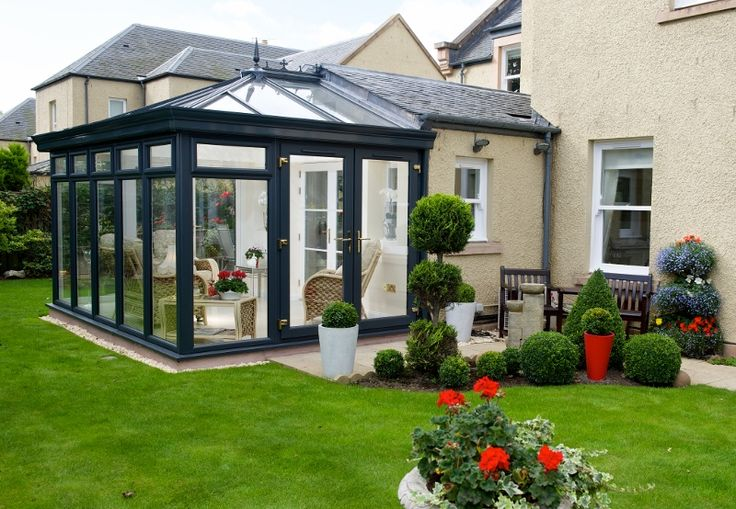 This anthracite grey orangerie is the perfect compliment to an already stunning home.