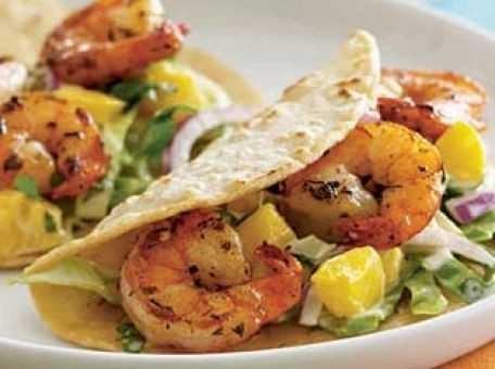 shrimp tacos with a mango coleslaw